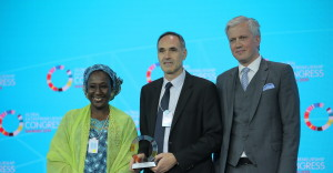 Frank Grozel, Coordinator of the Business Facilitation Programme, (middle) receives the award from H.E. Aisha Abubakar, Minister of Industry, Trade & Investment, Nigeria and Mr. Viljar Lubi, Deputy Secretary-General for Economic Development, Estonia